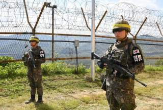 South Korean soldiers stand guard while removing landmines inside of the Demilitarized Zone (DMZ) on October 2, 2018 in Cheorwon, South Korea. Picture taken October 2, 2018. Song Kyung-Seok/Pool via REUTERS
