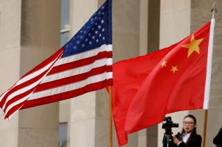 U.S. and Chinese flags are seen before Defense Secretary James Mattis welcomes Chinese Minister of National Defense Gen. Wei Fenghe to the Pentagon in Arlington, Virginia, U.S., November 9, 2018. REUTERS/Yuri Gripas