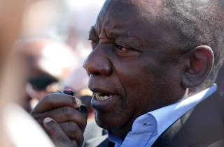 FILE PHOTO: South African President Cyril Ramaphosa speaks during a visit to crime ridden Hanover Park township to launch a new Anti-Gang Unit, in Cape Town, South Africa November 2, 2018. REUTERS/Mike Hutchings/File Photo