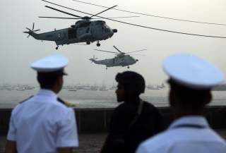 Indian Navy soldiers watch Sea King Mk 42 ASW helicopters during the rehearsal ahead of Navy Day celebrations in Mumbai, India, December 3, 2018. REUTERS/Francis Mascarenhas