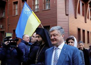 Ukrainian President Petro Poroshenko and his wife Maryna arrive for the Epiphany mass at the Patriarchal Cathedral of St. George in Istanbul, Turkey January 6, 2019. REUTERS/Murad Sezer