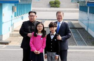 FILE PHOTO : South Korean President Moon Jae-in and North Korean leader Kim Jong Un attend a welcoming ceremony in the truce village of Panmunjom inside the demilitarized zone separating the two Koreas, South Korea, April 27, 2018. Korea Summit Press Pool