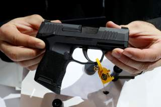 https://pictures.reuters.com/archive/USA-GUNS-SHOT-RC1F55AA6000.html