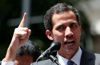 Venezuela's opposition leader Juan Guaido gestures as he speaks during a news conference in Caracas, Venezuela, January 25, 2019. REUTERS/Carlos Garcia Rawlins