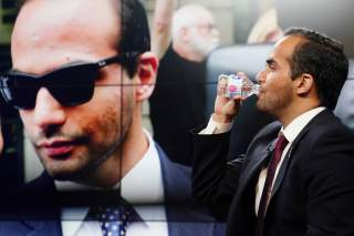 George Papadopoulos, a former member of the foreign policy panel to Donald Trump's 2016 presidential campaign, conducts a TV interview in New York, New York, U.S., March 26, 2019. REUTERS/Carlo Allegri