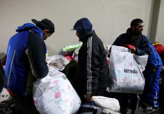 Homeless people receive donations at Argentine soccer team River Plate's stadium in Buenos Aires, Argentina, July 3, 2019. REUTERS/Agustin Marcarian