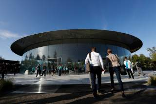 Guests arrive for at the Steve Jobs Theater for an Apple event at their headquarters in Cupertino, California, U.S. September 10, 2019. REUTERS/Stephen Lam