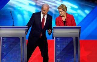 Former Vice President Joe Biden talks with Senator Elizabeth Warren during a break at the 2020 Democratic U.S. presidential debate in Houston, Texas, U.S. September 12, 2019. REUTERS/Mike Blake