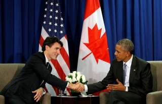 FILE PHOTO: U.S. President Barack Obama meets Canadian Prime Minister Justin Trudeau at the APEC Summit in Lima, Peru November 20, 2016. REUTERS/Kevin Lamarque/File Photo