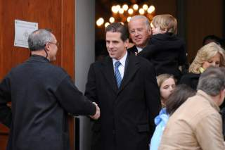 FILE PHOTO: U.S. Vice President Joe Biden and his son Hunter Biden depart after a pre-inauguration church service in Washington, U.S., January 18, 2009. REUTERS/Jonathan Ernst/File Photo
