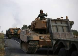 Turkish army vehicles are moving on a road near the Turkish border town of Ceylanpinar, Sanliurfa province, Turkey, October 18, 2019. REUTERS/Stoyan Nenov