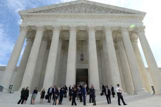 FILE PHOTO: People leave the Supreme Court after it resumed hearing oral arguments at the start of its new term in Washington, U.S., October 7, 2019. REUTERS/Mary F. Calvert/File Photo