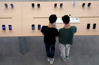 People look at smartphones in Huawei's first global flagship store in Shenzhen, Guangdong province, China October 30, 2019. REUTERS/Aly Song