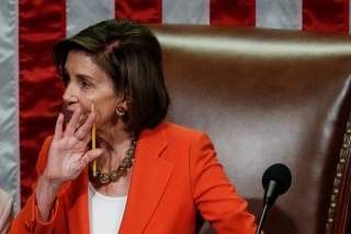 Speaker of the House Nancy Pelosi presides over the U.S. House of Representatives vote on a resolution that outlines the next steps in the impeachment inquiry of U.S. President Donald Trump on Capitol Hill in Washington, U.S.