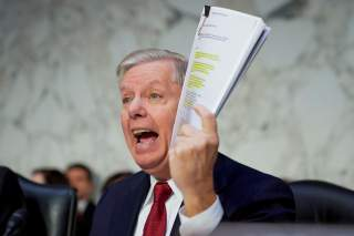 U.S. Senate Judiciary Committee Chairman Senator Lindsey Graham (R-SC) holds a copy of an intelligence report on the Steele dossier as he delivers an opening statement prior to hearing testimony from Justice Department Inspector General Michael Horowitz