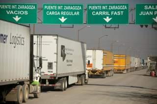 Trucks wait in a queue for border customs control, to cross into the U.S., at the Zaragoza-Ysleta border crossing bridge in Ciudad Juarez, Mexico December 12, 2019. REUTERS/Jose Luis Gonzalez