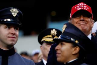 U.S President Donald Trump stands beside West Point military cadets during the annual Army-Navy collegiate football game at Lincoln Financial Field in Philadelphia, PA, U.S., December 14, 2019. REUTERS/Tom Brenner