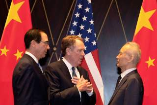 United States Trade Representative Robert Lighthizer gestures as he chats with Chinese Vice Premier Liu He with Treasury Secretary Steven Mnuchin, looking on after posing for a family photo at the Xijiao Conference Center in Shanghai, China, July 31, 2019
