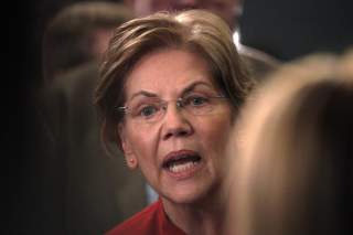 Senator Elizabeth Warren does an interview in the spin room after the sixth 2020 U.S. Democratic presidential candidates campaign debate at Loyola Marymount University in Los Angeles, California, U.S., December 19, 2019. REUTERS/Kyle Grillot