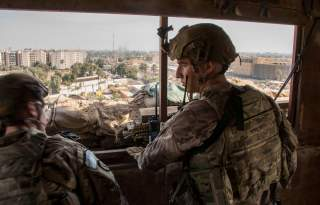 U.S. Army soldiers keep watch on the U.S. embassy compound in Baghdad, Iraq January 1, 2020. DoD/Lt. Col. Adrian Weale/Handout