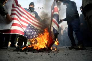 Demonstrators burn the U.S. and British flags during a protest against the assassination of the Iranian Major-General Qassem Soleimani, head of the elite Quds Force, and Iraqi militia commander Abu Mahdi al-Muhandis who were killed in an air strike