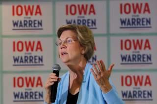FILE PHOTO: Democratic 2020 U.S. presidential candidate and U.S. Senator Elizabeth Warren (D-MA) speaks at a campaign town hall meeting in Grimes, Iowa, U.S., January 20, 2020. REUTERS/Brian Snyder/File Photo