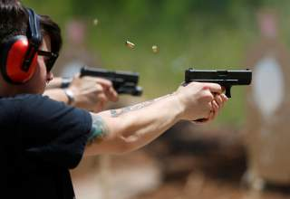 Skylar Simon shoots at targets during a firearms training class attended by members of the Pink Pistols, a national pro-gun LGBT organization, at the PMAA Gun Range in Salt Lake City, Utah, U.S., July 1, 2016. REUTERS/Jim Urquhart/File Photo