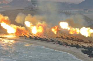 Artillery pieces are seen being fired during a military drill at an unknown location, in this undated photo released by North Korea's Korean Central News Agency (KCNA) on March 25, 2016. REUTERS/KCNA/File Photo ATTENTION EDITORS - THIS PICTURE WAS PROVIDE
