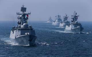 A fleet of ships sail out at sea as China and Russia's naval joint drill concludes in Zhanjiang, Guangdong Province, China, September 19, 2016.