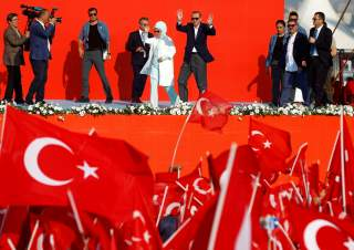 Turkish President Tayyip Erdogan and his wife Emine Erdogan attend Democracy and Martyrs Rally, organized by him and supported by ruling AK Party (AKP), oppositions Republican People's Party (CHP) and Nationalist Movement Party (MHP), to protest against l