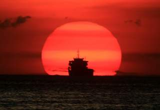 A cargo ship is silhouetted as the sun sets along the coast of Manila bay in Metro Manila, Philippines January 27, 2017. REUTERS/Romeo Ranoco