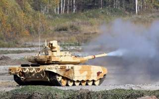 A Russian T-90 tank fires during the
