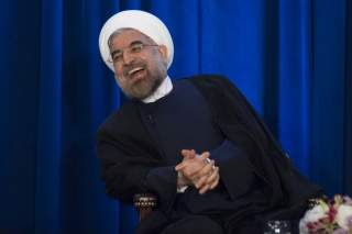 Iran's President Hassan Rouhani laughs as he speaks during an event hosted by the Council on Foreign Relations and the Asia Society in New York, September 26, 2013. REUTERS/Keith Bedford