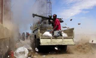 A Southern Popular Resistance fighter fires a weapon mounted on a truck during clashes with Houthi fighters in Yemen's southern city of Aden May 3, 2015. Between 40-50 Arab special forces soldiers arrived in Aden on Sunday and deployed alongside local fig