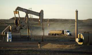 DATE IMPORTED:July 14, 2015A service truck drives past an oil well on the Fort Berthold Indian Reservation in North Dakota, November 1, 2014.