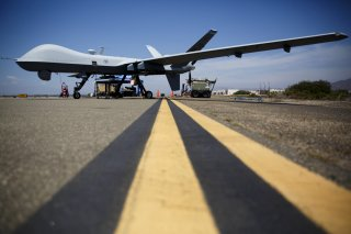 A General Atomics MQ-9 Reaper stands on the runway during
