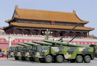 Military vehicles carrying DF-15B short-range ballistic missiles drive past the Tiananmen Gate during a military parade to mark the 70th anniversary of the end of World War Two, in Beijing, China, September 3, 2015. REUTERS/Jason Lee