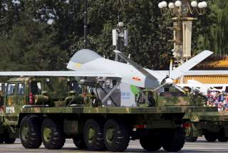 Military vehicles carrying Wing Loong, a Chinese-made medium altitude long endurance unmanned aerial vehicle, take part in a military parade to commemorate the 70th anniversary of the end of World War II in Beijing Thursday Sept. 3, 2015. REUTERS/Andy Won
