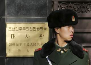 A paramilitary solider stands guard at the main gate of North Korea's embassy in Beijing January 6, 2016. North Korea said it had successfully conducted a test of a miniaturised hydrogen nuclear device on Wednesday morning.