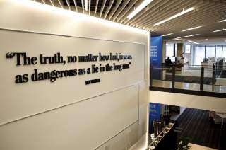 A quotation from former executive editor and journalism legend Ben Bradlee is seen on the newsroom floor during the grand opening of the Washington Post newsroom in Washington January 28, 2016. REUTERS/Gary Cameron