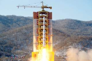 A North Korean long-range rocket is launched into the air at the Sohae rocket launch site, North Korea, in this photo released by Kyodo February 7, 2016.