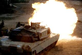 A U.S. M1 Abrams tank fires during the