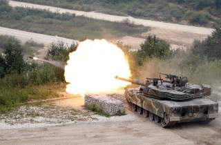 A South Korean army artillery tank fires during a live fire exercise ahead of the Defense Expo Korea 2016 near the demilitarized zone separating the two Koreas in Pocheon, South Korea, September 6, 2016. REUTERS/Kim Hong-Ji