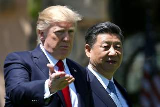 U.S. President Donald Trump and China's President Xi Jinping chat as they walk along the front patio of the Mar-a-Lago estate after a bilateral meeting in Palm Beach, Florida, U.S., April 7, 2017. REUTERS/Carlos Barria