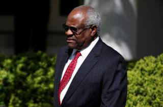 Associate Supreme Court Justice Clarence Thomas arrives for the swearing in ceremony of Judge Neil Gorsuch as an Associate Supreme Court Justice in the Rose Garden of the White House in Washington, U.S., April 10, 2017. REUTERS/Joshua Roberts