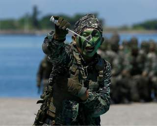 Marine corps demonstrate martial arts during a military drill at navy base in Kaohsiung, Taiwan July 13, 2017. REUTERS/Tyrone Siu