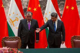 Chinese President Xi Jinping with Tajikistan's President Emomali Rahmon attend the signing ceremony during their meeting at the Great Hall of the People in Beijing, China August 31, 2017. REUTERS/Roman Pilipey/Pool