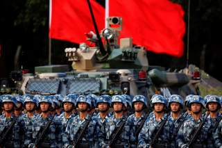 Troops prepare for the arrival of Chinese President Xi Jinping (unseen) at the People's Liberation Army (PLA) Hong Kong Garrison in one of events marking the 20th anniversary of the city's handover from British to Chinese rule, in Hong Kong, China June 30