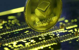 Representation of the Ethereum virtual currency standing on the PC motherboard is seen in this illustration picture, February 3, 2018. REUTERS/Dado Ruvic/Illustration