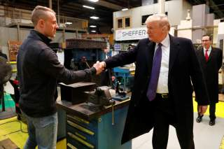 U.S. President Donald Trump meets workers as he takes a factory tour of the Sheffer Corporation in Blue Ash, Ohio, U.S. February 5, 2018. REUTERS/Jonathan Ernst